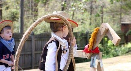 enfant jouant avec un lasso