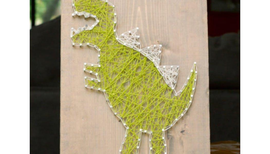 un dinosaure en string art