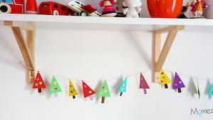 Fabriquer une guirlande de sapins en papier