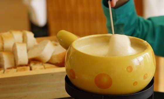 Recette de fondue : la fondue à la Vache qui rit ®
