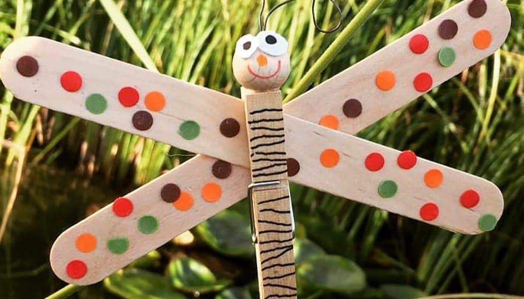amusant papillon en bâtonnets en bois type Esquimau