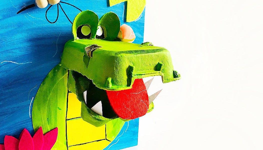 Un crocodile en boîte d'œufs