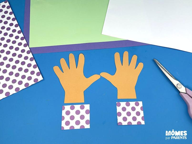 Découper les mains et le papier à motifs